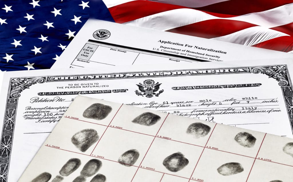 Certificate of Citizenship, fingerprint card and application for naturalization, isolated on white