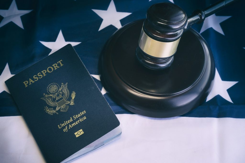 passport next to a pommel and gavel on US stars